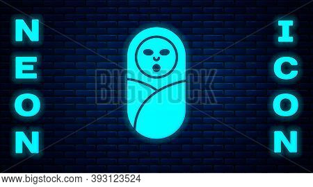 Glowing Neon Newborn Baby Infant Swaddled Or Swaddling Icon Isolated On Brick Wall Background. Baby