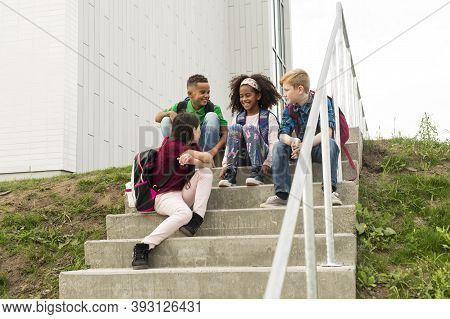 Group Pre-teen School Pupils Outside Of The Classroom