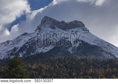 Snowy Castillo De Acher Mountain, Surrounded By Beech And Coniferous Forest, Is 2384 Meters High And