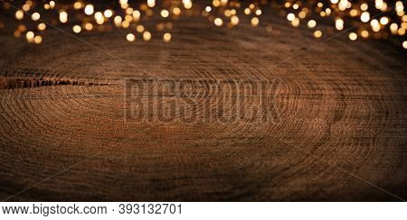 Festive Golden Bokeh Lights With Empty Rustic Natur Wood. Horizontal Dark Brown Christmas Background