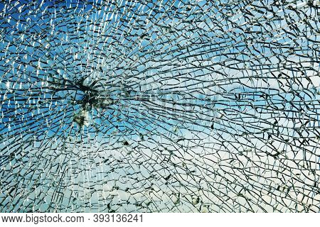 Broken Window Made Of Safety Laminated Glass After A Stone Throw, Shows A Characteristic Circular Sp