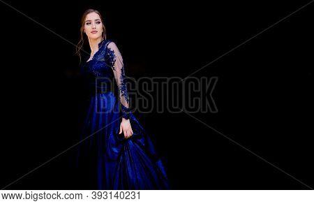Portrait Of Beautiful Teen Girl In Beautiful Ultramarine Prom Dress Prom Dress. Black Background. Gl