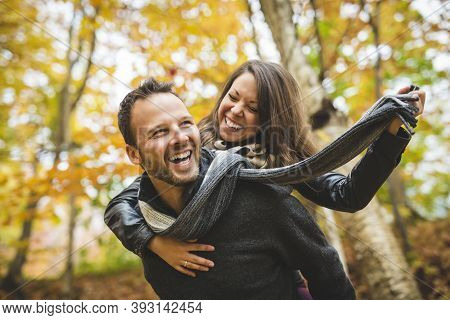 Young Couple In Love In A Park On A Autumn Day