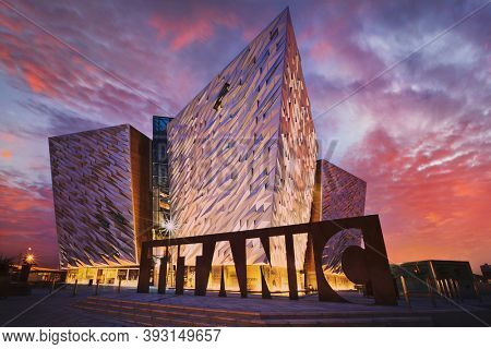 BELFAST, NORTHERN IRELAND - JUNE 28, 2017: Sunset over Titanic Belfast - museum, touristic attraction and monument to Belfast's maritime heritage on the site of the former Harland and Wolff shipyard.