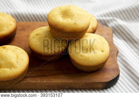 Homemade Cornbread Muffins On A Rustic Wooden Board, Low Angle View. Close-up.