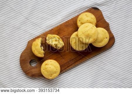 Homemade Cornbread Muffins On A Rustic Wooden Board, Overhead View. Flat Lay, From Above, Top View.