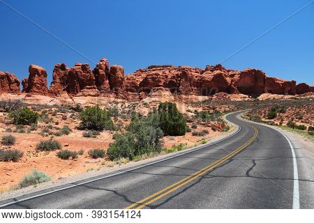 American Road. Arches Scenic Drive At Arches National Park, Utah. American Landscape.