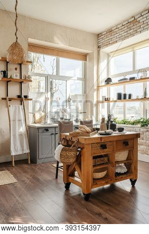 Vertical Side View Of Stylish Sunny Kitchen Interior With Kitchenware, Home Decor And Accessories, W