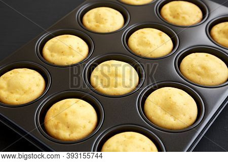 Homemade Cornbread Muffins On A Black Background, Side View. Close-up.
