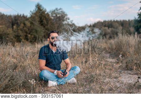 Brutal Vape Man Blows Up A Couple An Electronic Cigarette In The Outdoors. Electronic Cigarette As A