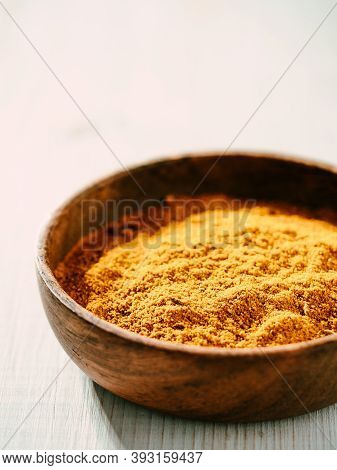 Indian Or Pakistani Masala Powder In Small Wooden Bowl. Homemade Dry Curry Garam Masala Mix Blend On