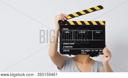 Girl Or Woman Hand's Holding Black Clapper Board Or Movie Slate Use In Video Production ,film, Cinem