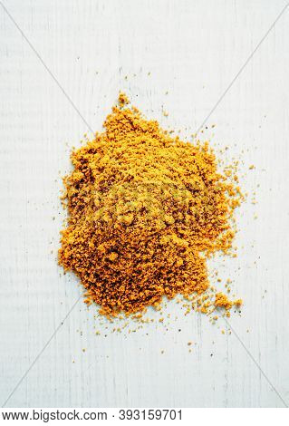 Heap Of Garam Masala On White Wooden Background. Indian Or Pakistani Masala Powder Heap, Top View Or