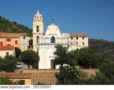 Facade And Tower Of The Roman Catholic Church Of The Assumption In Cargese From The Greek Catholic C