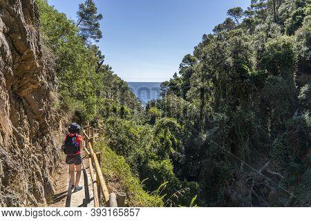 Hiker Woman Going Down Towards