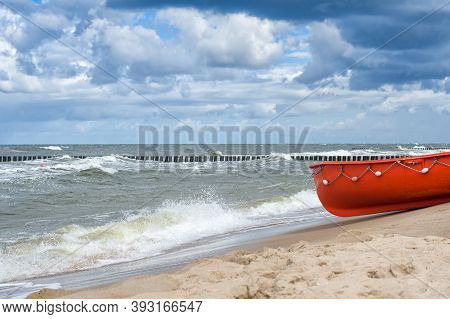 Wooden Fishing Boat On The Beach In Poland. Baltic Sea