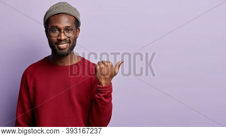 Satisfied Black Guy With Stubble, Has Toothy Broad Shining Smile And White Teeth, Wears Headgear And