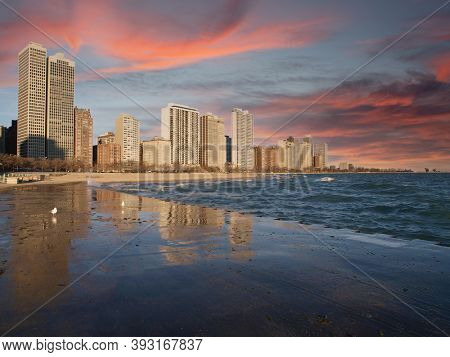 Chicago Illinois lakefront skyline view with early morning sunrise sky.