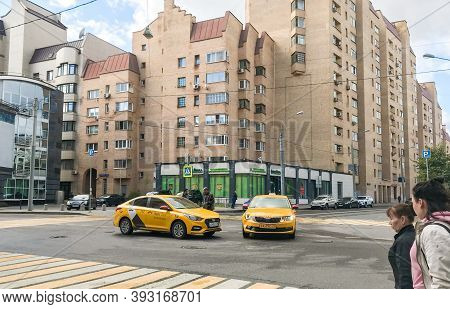Moscow, Russia, September 2020: Car Accident. Two Taxi Cars Crashed At The Empty Crossroad. Drivers