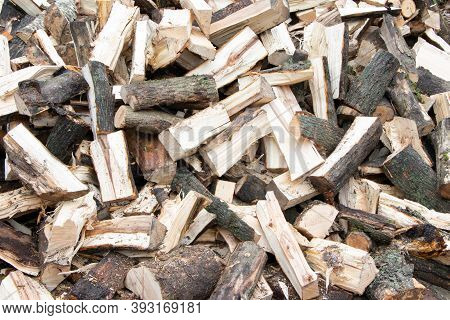 Heap Of Chopped Firewood Background. Pile Of Split Firewood. Stack Of Fuel Wood