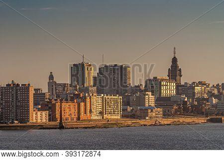 Montevideo, Uruguay- December 18, 2008: City Skyline Along Rambla Gran Bretana With Iconic Tower Of