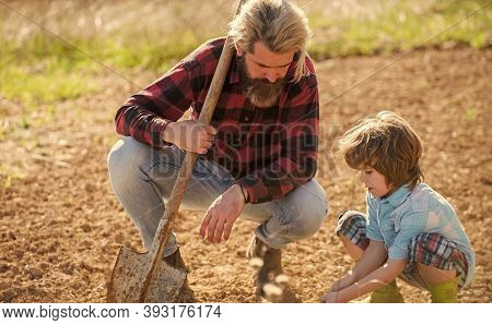 Where Food Comes From. Teaching Son Growing Plants. Planting Plants. Works In Field. Father Farmer I