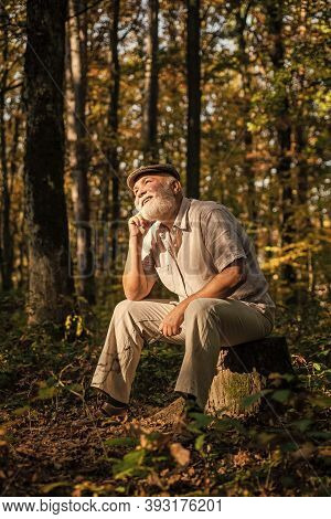 Back Into The Wild. Senior Man Relax In Wild Nature. Aged Pensioner Enjoy Autumn Landscape. Wild Fau