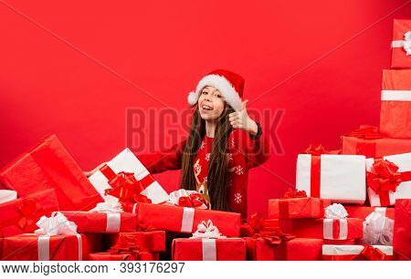 Child Happy Girl Find Gifts Christmas Tree. Merry Christmas. Happy Childhood Concept. Happiness And