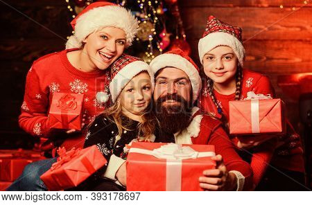 Christmas Joy. Christmas Tradition. Happy Holidays. Parents And Children Opening Christmas Gifts. Ch