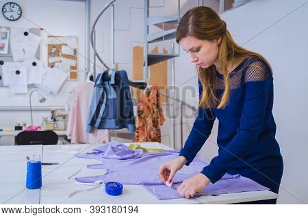 Portrait Of Professional Dressmaker, Designer Holding Chalk And Measuring Cloth For Sewing In White