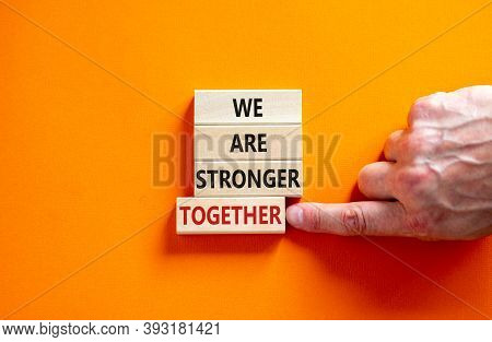 Wooden Blocks With Words 'we Are Stronger Together'. Beautiful Orange Background, Male Hand. Copy Sp