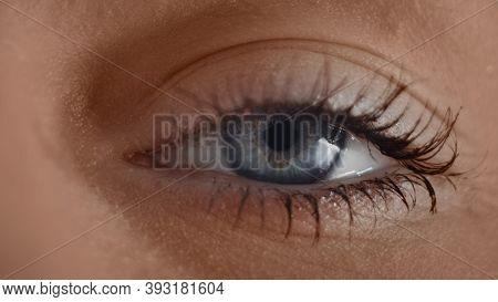 Extreme Close-up Of The Iris Of A Girl's Human Blue Grey Eye. Macro Close Up Eye Blinking And Lookin