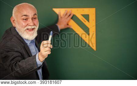 Logic That Is Involved. Favorite Subject. Senior Man Teacher Use Math Triangle Tool. Bearded Tutor M