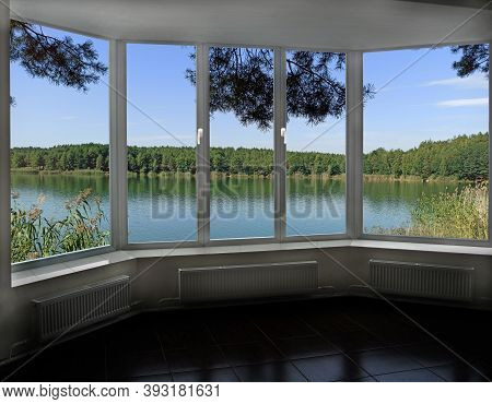 Window In Modern Cozy Room With Panoramic View To Forest Lake. View From Window To Pine Forest And L