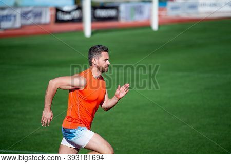 Best Exercise. Successful Fitness Sprinter. Male Coach On Stadium Running Track. Endurance And Stami