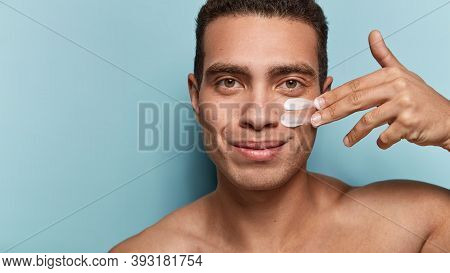 Close Up Shot Of Attractive Man With Healthy Skin, Applies Cream For Anti Wrinkle Or Anti Aging, Car