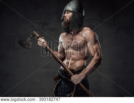 Strong And Furious Nord Barbarian Posing In Dark Studio Background Holding His Two Handed Axe On Han