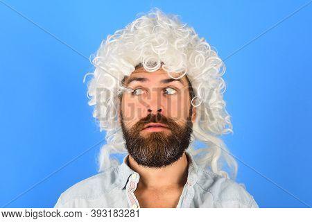 Emotions. Man In Wig. Surprised Man In Curly Wig. Surprised Bearded Man. Portrait Of Surprised Man.