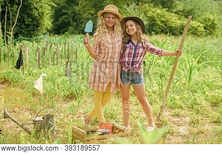 Girls In Hats Planting Plants. Rustic Children Nature Background. Eco Farming Concept. Planting And