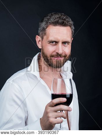 Guy Drink Red Wine. Cheers For Happy Valentines Day. Alcohol Drinking. Handsome Male On Romantic Dat