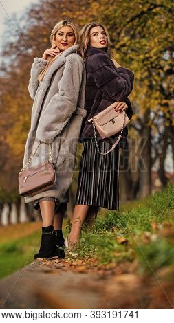 Fall Outfit. Beautiful Ladies Walking In Warm Clothes. Gorgeous Girls. Beauty And Fashion Concept. D