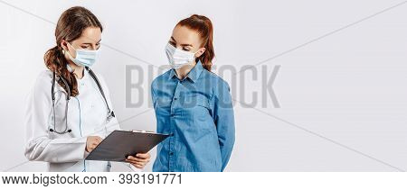Woman Patient At Doctor In Masks At Reception To Check Health On White Isolated Background