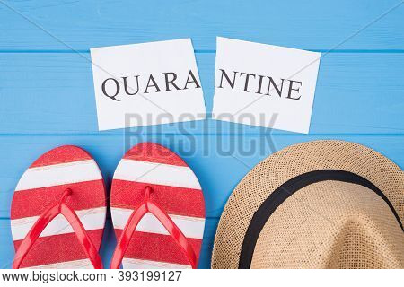 End Quarantine Concept. Top Above Overhead View Photo Of Torn Word Quarantine Flipflops And Hat Isol