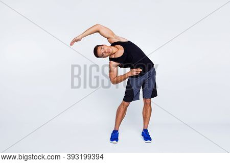 Full Length Body Size View Of His He Nice Attractive Focused Sportive Guy Doing Inclines Stretching