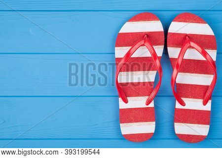 Top Above Overhead View Close-up Photo Of A Pair Of Striped Flipflops Placed To The Right Side Isola