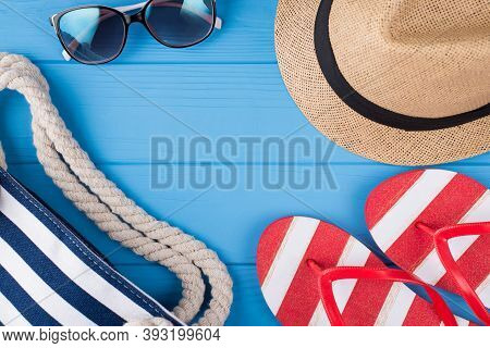 Summer Vacation Concept. Top Above Overhead View Photo Of Bag Sunglass Hat And Flipflops Isolated On