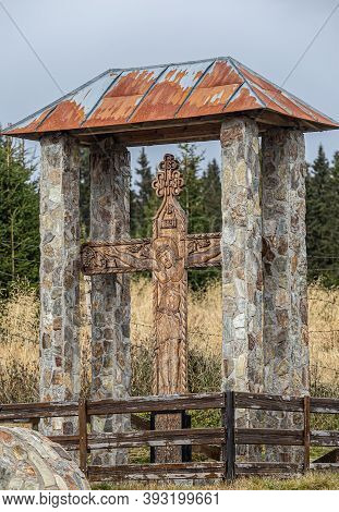 Transalpina,  Romania - October 24, 2020:  Crucifix Crucifix Located In The Mountain Resort Ranca  O