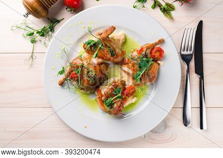 Roasted Or Fried Whole Quails With Herbs On Wooden Table, Fried Partridge At A White Plate Top View,
