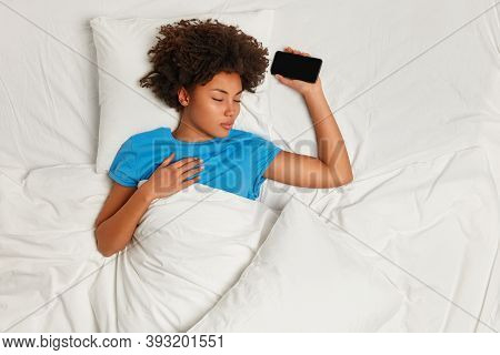 Being Always With Modern Technologies. Restful Calm Woman Falls Asleep Mobile Phone In Hand While Me