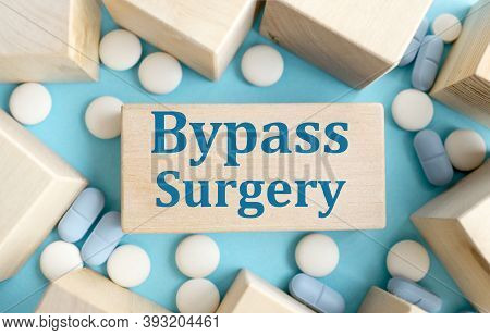 Bypass Surgery, Text On A Block Of Wood On A Blue Background